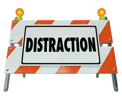 Distraction word on a road construction barrier or sign